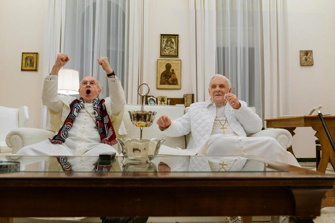 **The Two Popes (20/12/2019)** <br><br> Frustrated with the direction of the church, Cardinal Bergoglio (Jonathan Pryce) requests permission to retire in 2012 from Pope Benedict (Anthony Hopkins). Instead, facing scandal and self-doubt, the introspective Pope Benedict summons his harshest critic and future successor to Rome to reveal a secret that would shake the foundations of the Catholic Church. Behind Vatican walls, a struggle commences between both tradition and progress, guilt and forgiveness, as these two very different men confront their pasts in order to find common ground and forge a future for a billion followers around the world. Inspired by true events.