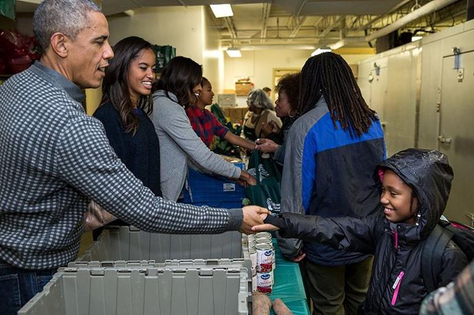 The Obama family serving Thanksgiving food at a food bank.