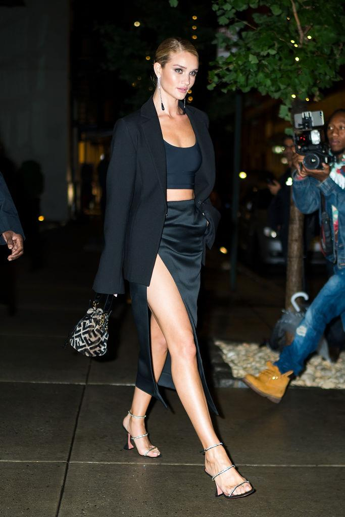 """Rosie Huntington-Whiteley wearing the 'Gilda' crystal-embellished satin sandals by Aminua Muaddi, approximately $1,343 from [MATCHESFASHION.COM](https://www.matchesfashion.com/au/products/Amina-Muaddi-Gilda-crystal-embellished-satin-sandals--1308672