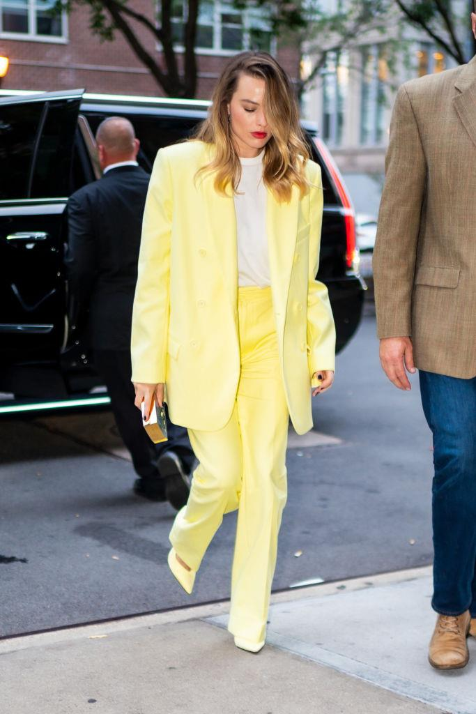 """Margot Robbie wearing the 'Venus' satin slingback with ankle strap in yellow by The Attico, $1,107 from [My Theresa](https://www.mytheresa.com/en-au/the-attico-satin-slingback-pumps-1232353.html?catref=category