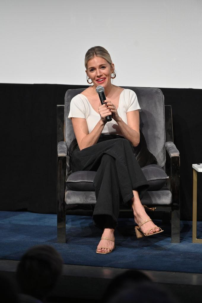 """Sienna Miller wears the 'Tanya' mules in nude patent leather by By Far, $475 from [By Far](https://www.byfar.com/products/tanya-nude-patent-leather?variant=7197874913326