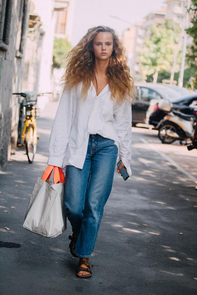 Stay casual and comfortable (with a touch of polish) while running errands in an airy white shirt, mum jeans and Birkenstocks (or similar).