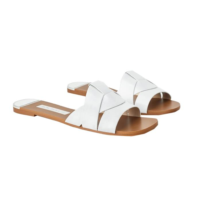 "Slides, $59.95 at [ZARA](https://www.zara.com/au/en/flat-leather-criss-cross-strap-sandals-p12859001.html?v1=37333754&v2=1277501|target=""_blank""|rel=""nofollow"")."
