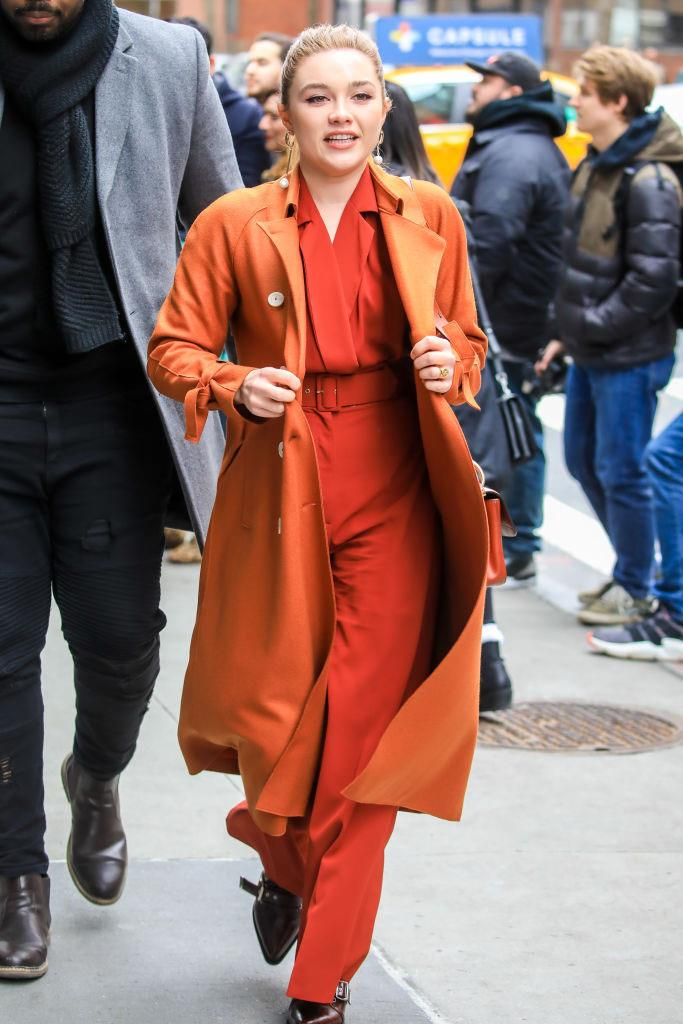 In an orange jumpsuit and coordinating trench coat in February 2019. <br><br> *Image: Getty*