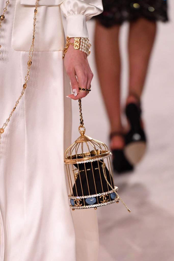 **A birdcage bag:** It's 2019, and if handbags that prioritise aesthetics over practicality are wrong, then we don't want to be right.