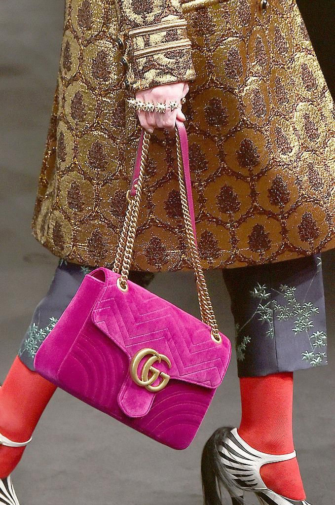 **2016: The Gucci 'Marmont'** <br><br> Every fashionphile remembers Gucci's renaissance in the mid-2010s, during which Alessandro Michele's 'GG'-adorned 'Marmont' bag became a must-have. Though the pink version (pictured) is no longer produced, it now comes in a variation of prints, colours and materials.