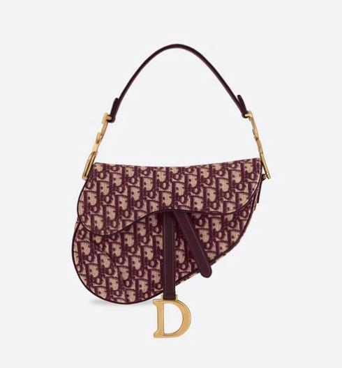 "*'Saddle' oblique bag by Dior, enquire for pricing at [Dior](https://www.dior.com/en_int/products/couture-M0446CTZQ_M974-dior-oblique-saddle-bag|target=""_blank""