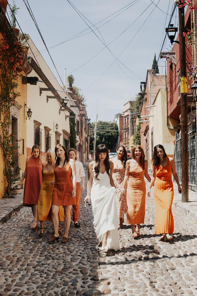 **What did your bridal party wear?**  <br><br> Each bridesmaid picked their own look with a colourway in mind—persimmon orange was the inspiration, and they ended up doing a range of complementary colours which looked great.