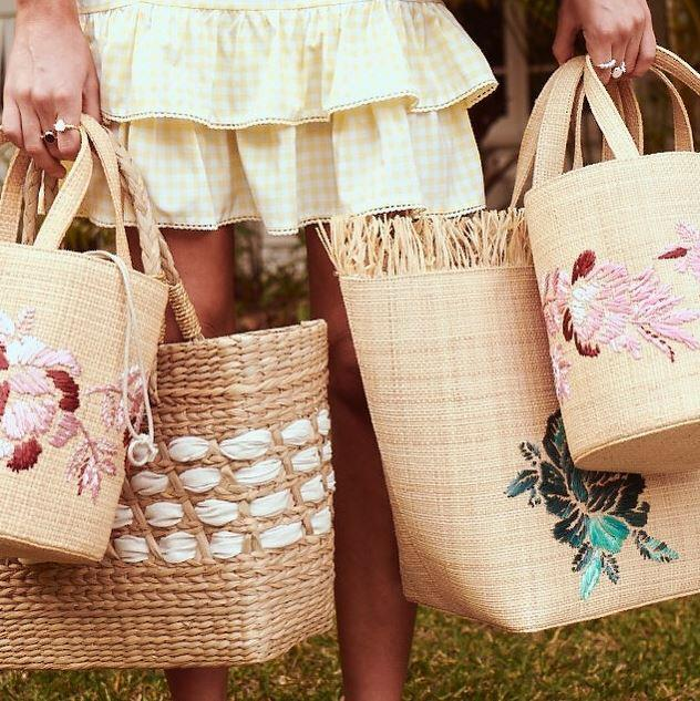 "**Tigerlily** <br><br> Straw bags with floral embroidery and summery, feminine touches. <br><br> *[Shop them here.](https://fave.co/2PeivS5|target=""_blank""
