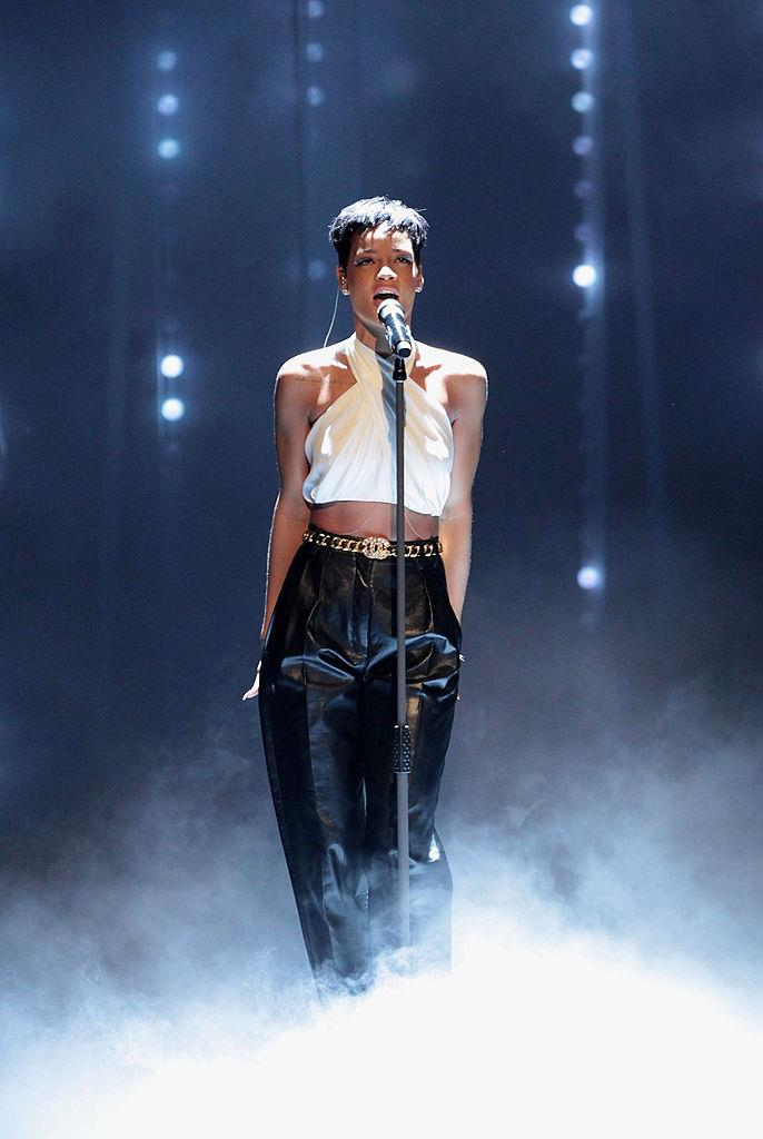 Rihanna in a white halterneck tank top and leather trousers on the German variety show *Wetten, dass..?* in December 2012.