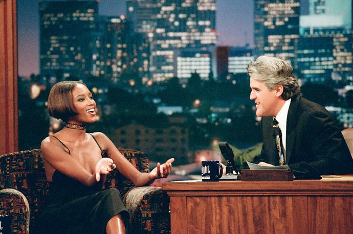 Naomi Campbell in a black slip-dress on *The Tonight Show with Jay Leno* in November 1996.