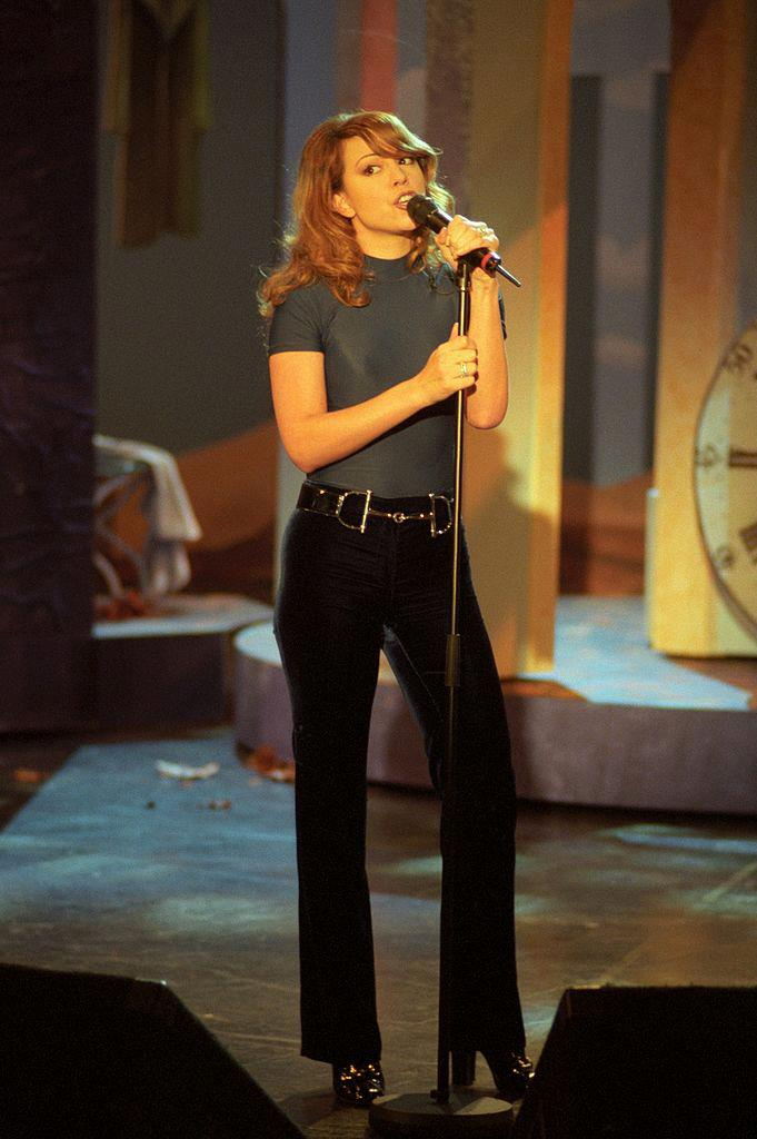 Mariah Carey in a Gucci by Tom Ford belt and shoes on the German variety show *Wetten, dass..?* in January 1996.