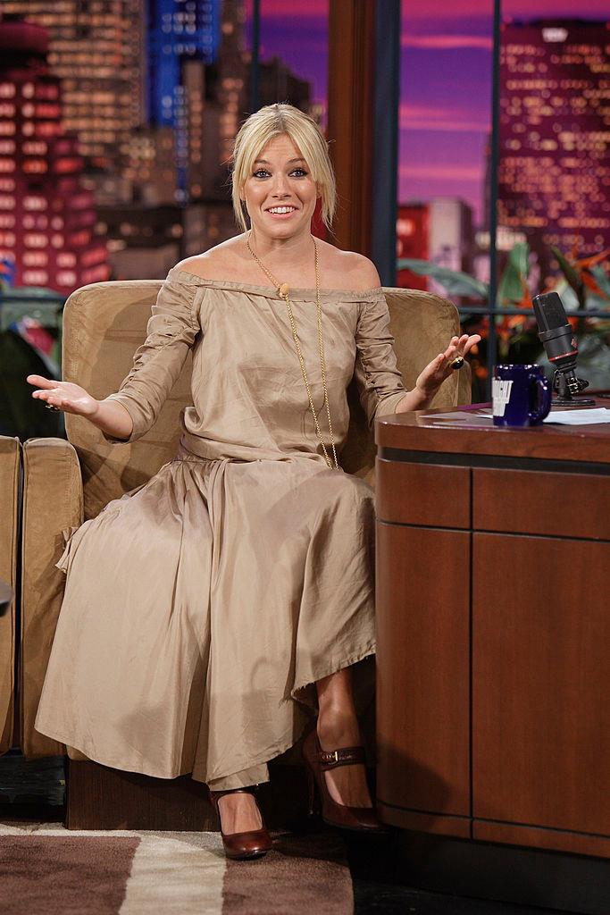 Sienna Miller in a strapless khaki dress on *The Tonight Show with Jay Leno* in January 2007.
