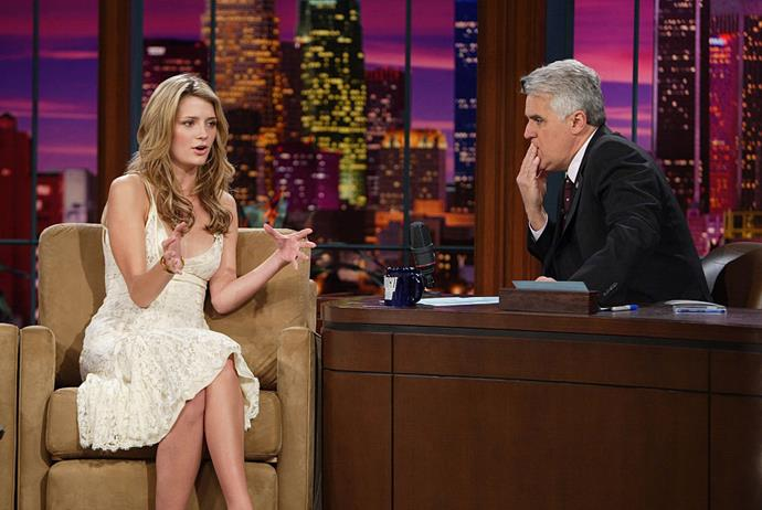 Mischa Barton in a white lace dress on *The Tonight Show with Jay Leno* in April 2005.