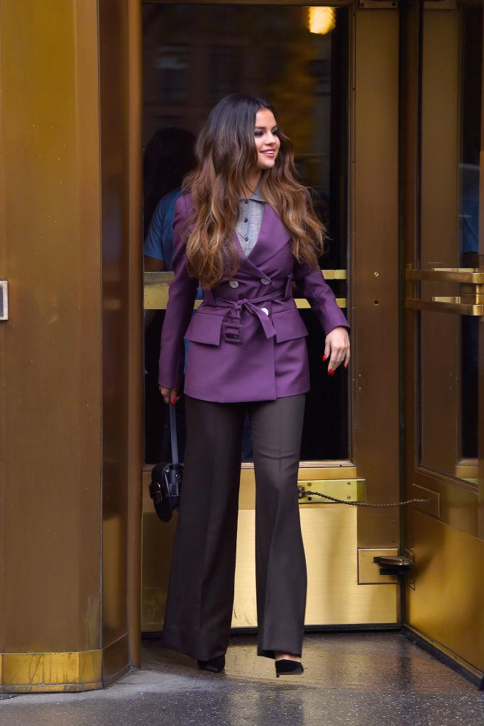 Wearing coordinated purple separates in NYC on October 29, 2019.