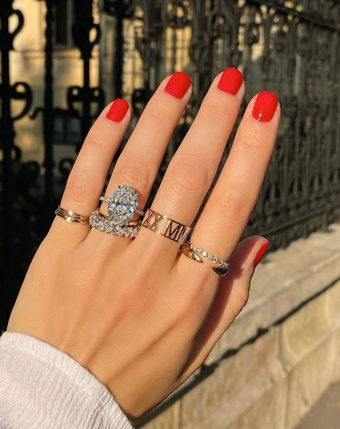 "**CLASSIC RED** <br><br> ""If you are a classic girl but like to stand out then a red is a good option. It's feminine yet bold, and really suits gold jewellery,"" Papadopoulos advises. <br><br> *Image: [@ringconcierge](https://www.instagram.com/p/B318Mlpp_v0/