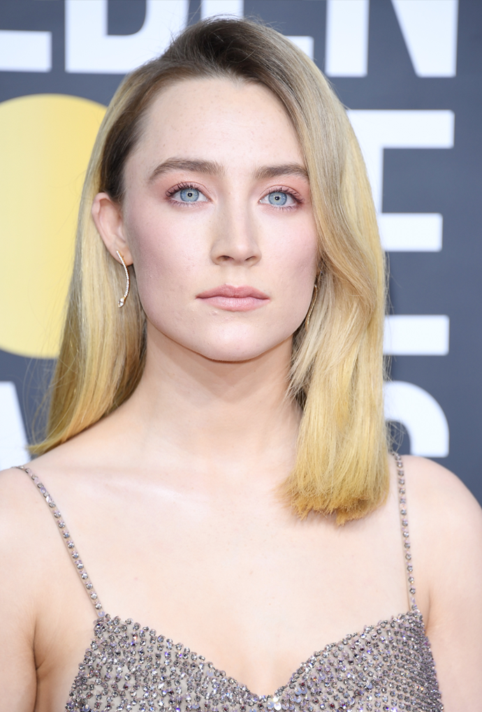 **Saoirse Ronan**<br> Ronan's deep side part puts her shadowy roots on show, and they only make her blonde appear brighter.