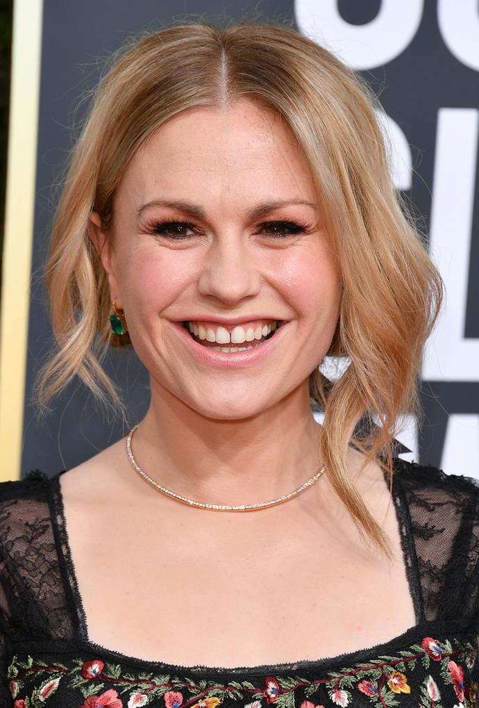 **Anna Paquin**<br> Call it a root shadow, but the hazelnut hue around Paquin's part compliments her honey tone beautifully.