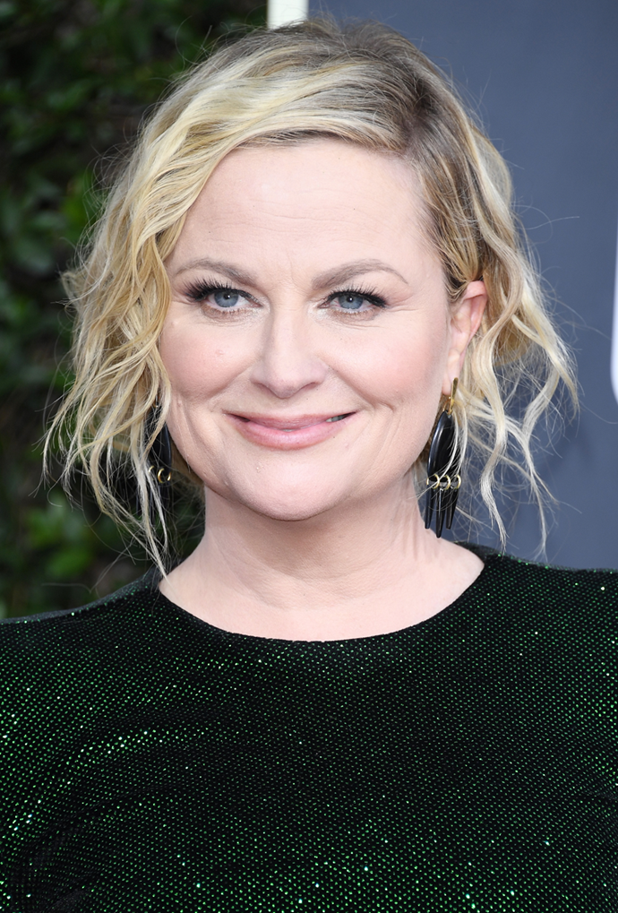 **Amy Poehler**<br> Poehler's salt and pepper action only enhances the undone feel of her tousled waves.