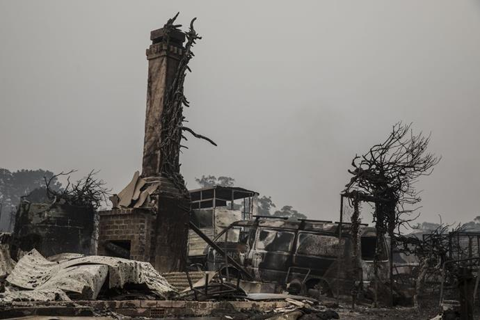 "**Jessica Hromas, *The Guardian* picture editor** <br><br> ""This is a house on Railway Parade, Wingello, NSW, the morning after the fire ripped through on January 5. I felt almost awkward taking these photos, like I was shining a light on someone else's misery and demise, but I also thought to myself, 'it is important for people to know what is happening, and that many people are suffering'. This picture shows: Look here, this is what is left of someone's precious home."" <br><br> *Image: @jessicahromas/*The Guardian"