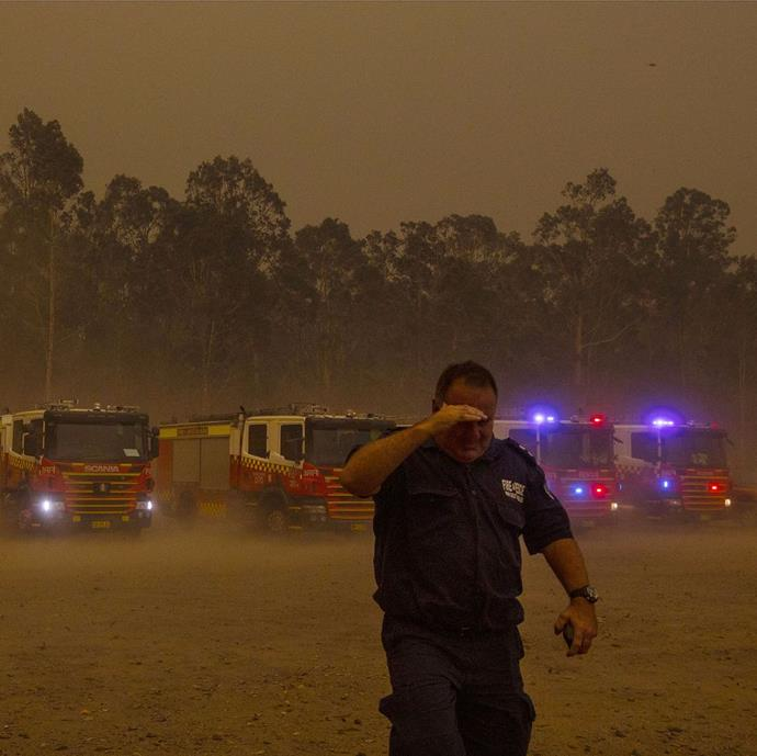 "**Jessica Hromas, *The Guardian* picture editor** <br><br> ""This photo was taken at the emergency staging ground at the Nowra Rugby Club, when the southerly winds hit. In moment, the sky turned from day to night and the winds came through like a freight train. Everything around us was red and angry. That night, the Currowan Fire jumped Shoalhaven River sending the fire north, burning and destroying properties in Kangaroo Valley, Bundanoon and Wingello. It was a scary afternoon, and I wanted to capture the drama. I also had to think about where we might go next, a balance between getting good photos but also staying safe."" <br><br> *Image: @jessicahromas/*The Guardian"