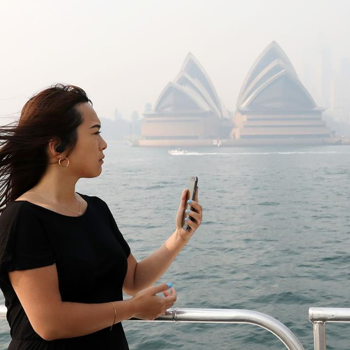 "**Cassie Trotter, Getty's Director of Editorial, Asia Pacific** <br><br> ""I'm rarely on the front lines in my role. I'm typically behind the scenes providing editorial direction, coordinating teams and photographers from the safety of my home or office. But as fires raged just on the outskirts of Sydney, and the smoke and haze created hazardous air conditions and poor visibility, the front lines felt so much closer. <br><br> My appreciation for the fire crews, journalists and photojournalists on the ground reached a new level of understanding. I struggled to breathe comfortably from the ferry on my commute to the office, while others were putting their whole bodies in the line of fire. <br><br> One of the most recognisable and photogenic landmarks in Australia is the Sydney Opera House. People know the iconic white sails and there is no shortage of pictures of it standing clean against a blue sky and surrounded by beautiful blue water in a city known for its temperate weather, fresh air and picturesque harbour. But for several days, the sails could hardly be seen, shrouded in smoke and hazardous air, highlighting the scale and size of the fires burning dozens of kilometres away. <br><br> It's important to capture images like these, ones people can relate to around the world if only to help illustrate the scope and scale of disasters like Australia is experiencing. Forests are being decimated, homes destroyed, lives lost. Covering the crisis is challenging. There is often over 100 fires burning simultaneously across new South Wales alone, posing different levels of threat to people and communities. <br><br> Covering bushfires is dangerous and unpredictable and for safety reasons, editors look for qualified and experienced photojournalists to put in the field. There are not many, and the conditions are tough, so both editor and photographer need to balance the time photographers work in the field in extreme conditions to prevent exhaustion."" <br><br> *Image: Cassie Trotter/Getty*"