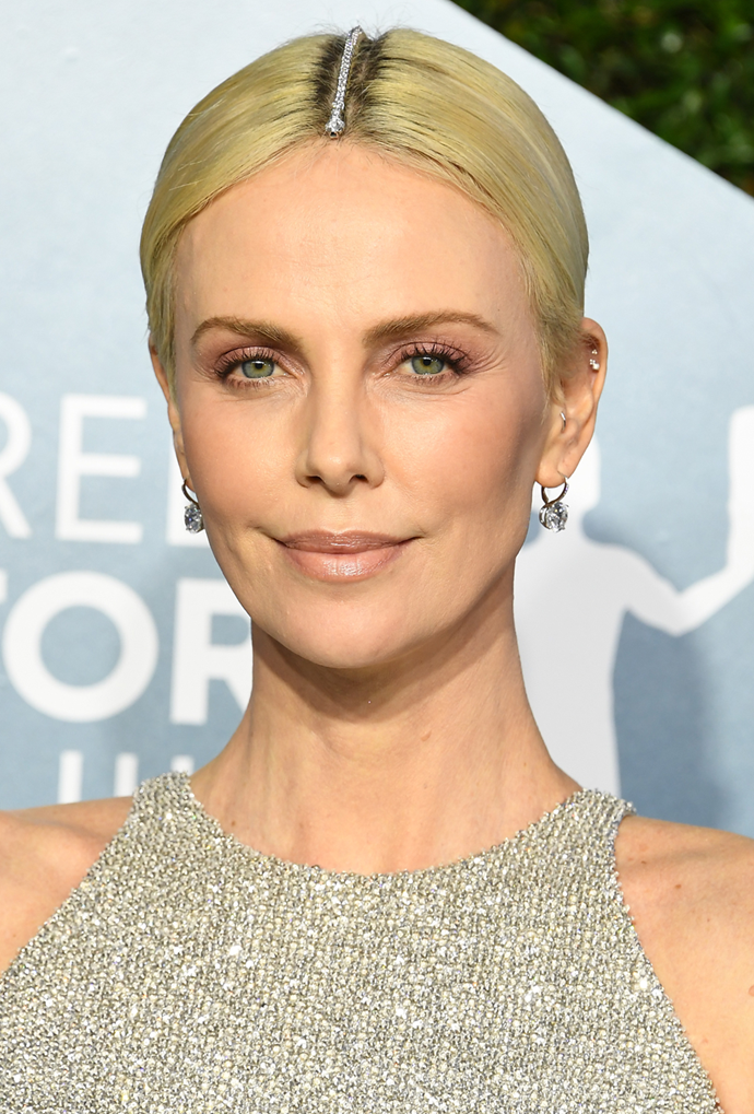**Charlize Theron**<br></br> Theron isn't just embracing, she's *accessorising*.