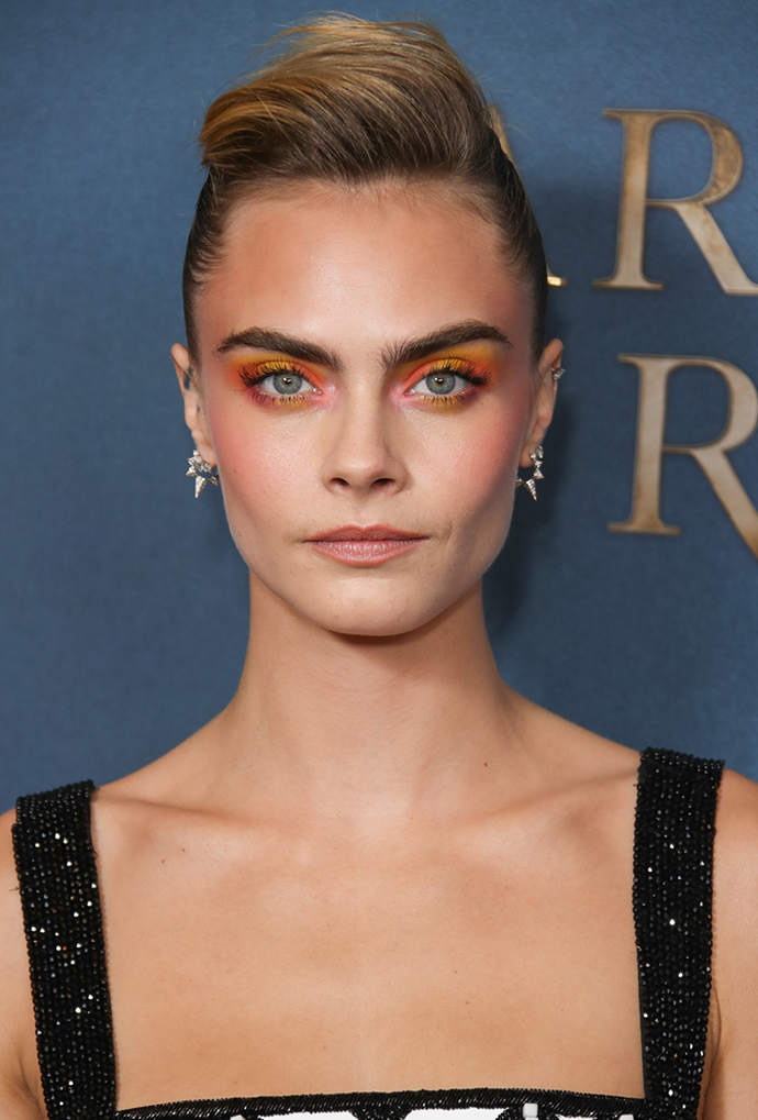 **Cara Delevingne**<br></br> Delevingne's dark roots are a perfect colour match for her iconic brows.