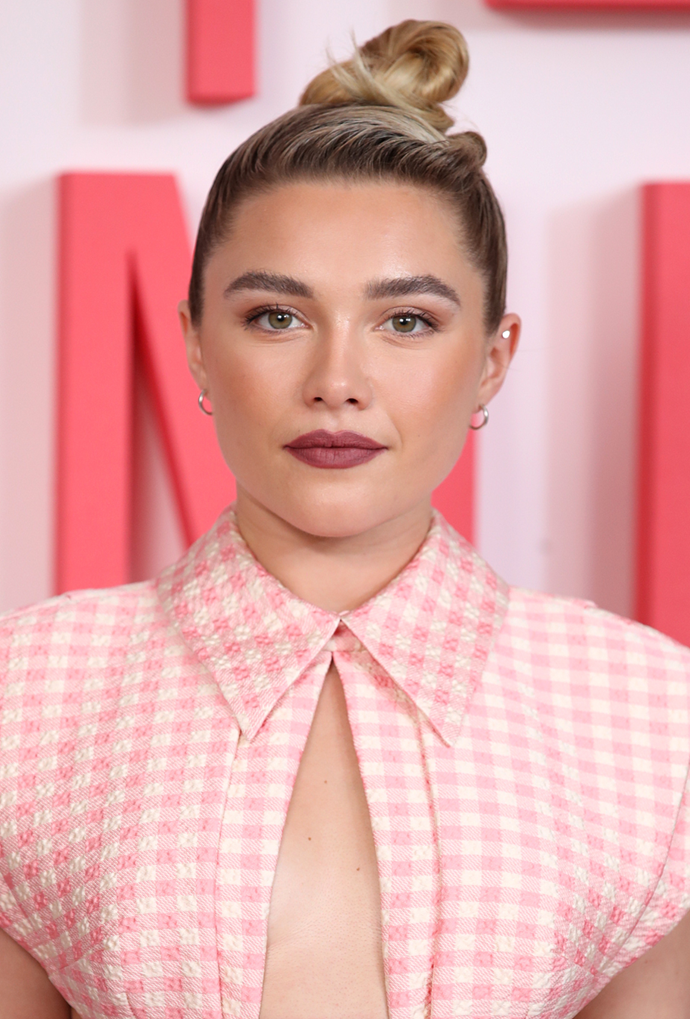 **Florence Pugh**<br></br> Pugh forgoes a part, slicking her grown-out strands straight back.