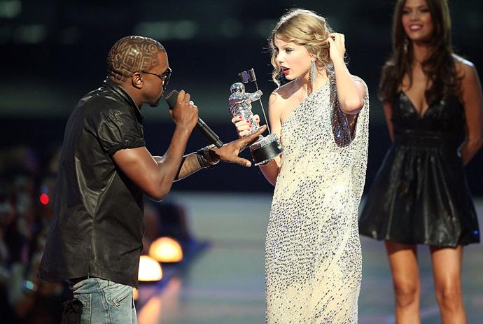"""Kanye West jumps onstage after Taylor Swift won the """"Best Female Video"""" award during the 2009 MTV Video Music Awards at Radio City Music Hall on September 13, 2009 in New York City."""