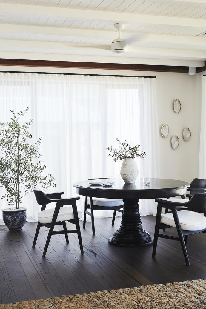 "Linen curtains are used throughout the home for their ""softening"" effect."