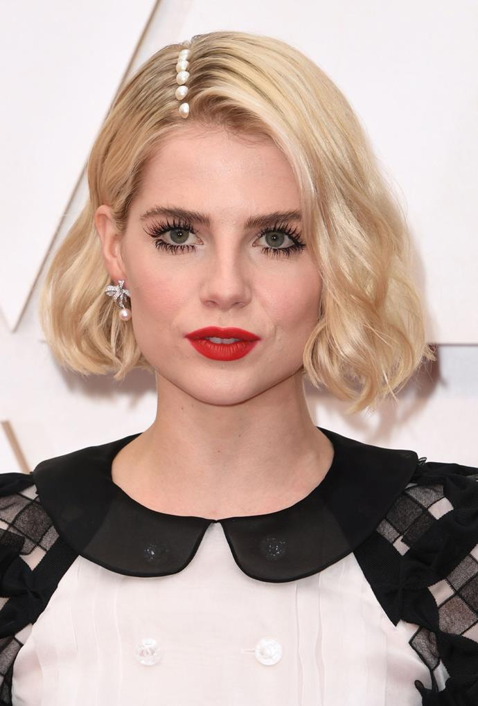Not satisfied with a simple jet-black lash and red lip combo, she put a 2020 spin on an Old Hollywood classic with a pearl-adorned side part. Bonus points for the deliciously creamy blonde, too.
