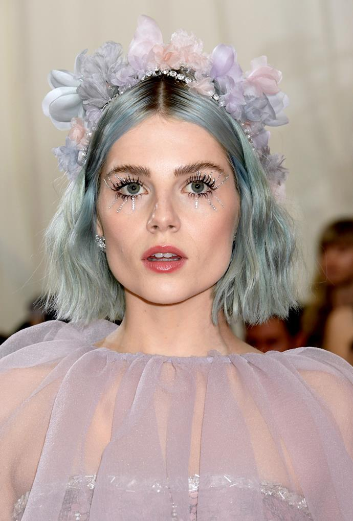 An event where experimental beauty is not only encouraged, but expected, The Met Gala doubles as Boynton's personal playground. She delivered with a dusky blue hair hue and diamonte spider lashes.