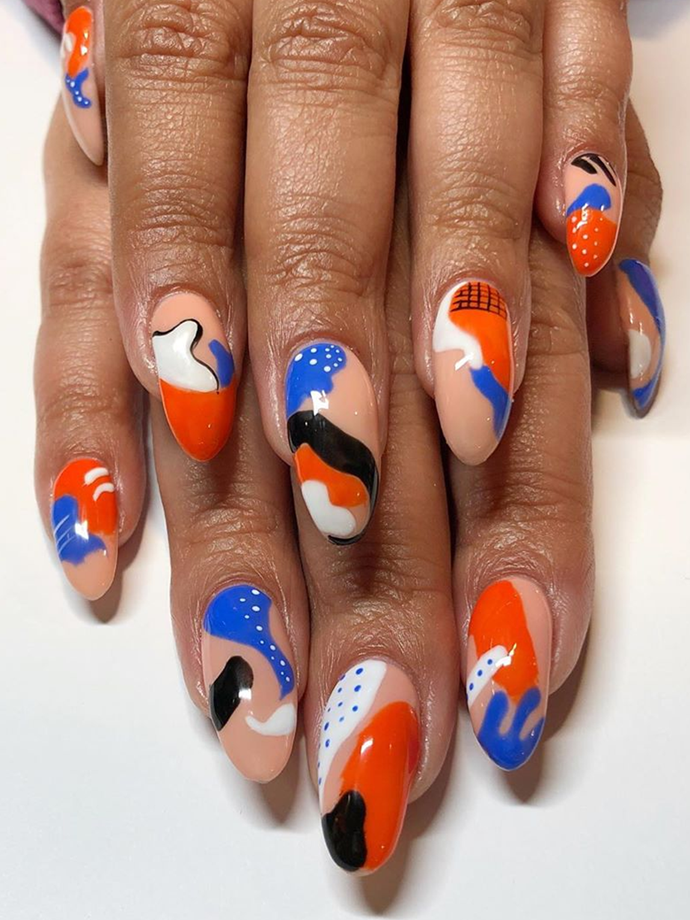 Splatter outlines, hatch-patterns, drip effects—this look has it all.<br></br> *Image via: @whodidhernails*