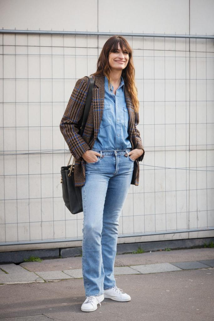 **Neo-bourgeoisie** <br><br> We're reminded of this every season when Paris Fashion Week rolls around, but no matter what anyone says, denim and sneakers will *always* be chic. Just ask Chanel muse Caroline de Maigret, whose denim-and-sneakers look at Dries van Noten's show looked eternally effortless.