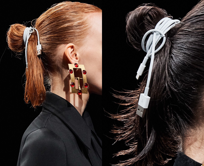**The trend: Tech ties<br> Who did it: Balenciaga**<br> In addition to the flooded runway and apocalyptic LED screens, Balenciaga's hair accessories were also on the statement-making side; to be specific, the topknots were tied with actual iPhone charging cables.