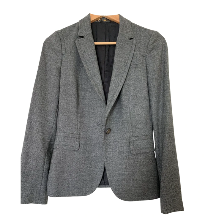 "**The unmissable vintage piece** <br><br> While many of us are looking to curb our environmental impacts, one thing we *can* do is buy investment pieces where possible, or build up our vintage fashion knowledge. That's where vintage shopping comes in, especially with blazers—including this repurposed (and extremely discounted) Gucci blazer from vintage treasure trove Vestiaire Collective. <br><br> *Vintage wool blazer by Gucci, $613 at [Vestiaire Collective](https://www.vestiairecollective.com/women-clothing/jackets/gucci/grey-wool-gucci-jacket-7464063.shtml|target=""_blank""