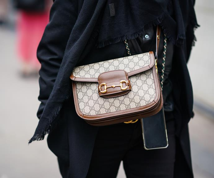 **The chic 'logomania' piece:** The Gucci '1995' Horsebit bag <br><br> As popular as Gucci's 'Marmont' bags are, they're definitely more of a trend piece, and when we're talking eternal timelessness, the brand's '1955' Horsebit bag is the first that comes to mind. Featuring a '50s-inspired shape and the brand's iconic horsebit emblem (you know, the one on their loafers), we challenge you to find an outfit that this bag won't work with.