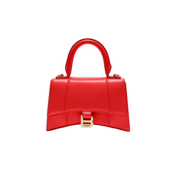 "*Small leather 'Hourglass' bag by Balenciaga, $2,490 at [24 Sèvres](https://fave.co/2U0SJlM|target=""_blank""