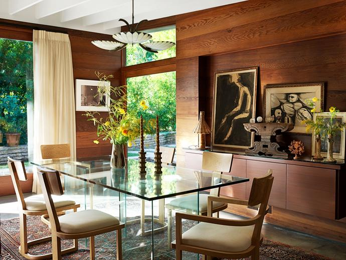 """The dining room. <br><br> *Image by Simon Upton for [Architectural Digest](https://www.architecturaldigest.com/story/step-inside-dakota-johnsons-midcentury-modern-home