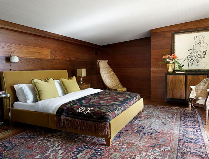 """The bedroom, featuring artwork by David Hockney and a monogrammed Gucci blanket. <br><br> *Image by Simon Upton for [Architectural Digest](https://www.architecturaldigest.com/story/step-inside-dakota-johnsons-midcentury-modern-home