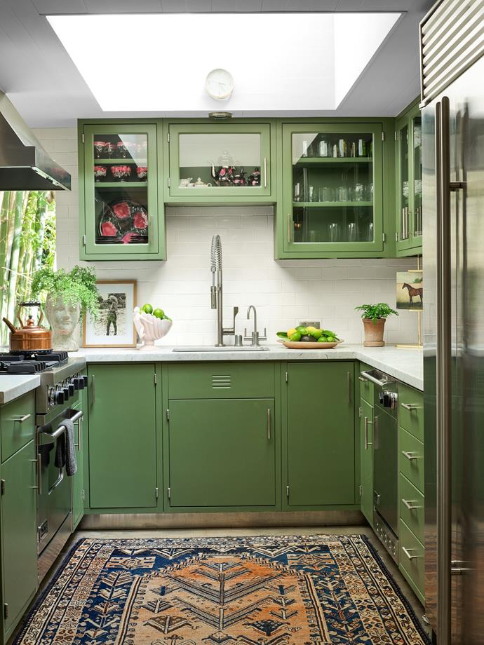"""The green-hued kitchen. <br><br> *Image by Simon Upton for [Architectural Digest](https://www.architecturaldigest.com/story/step-inside-dakota-johnsons-midcentury-modern-home