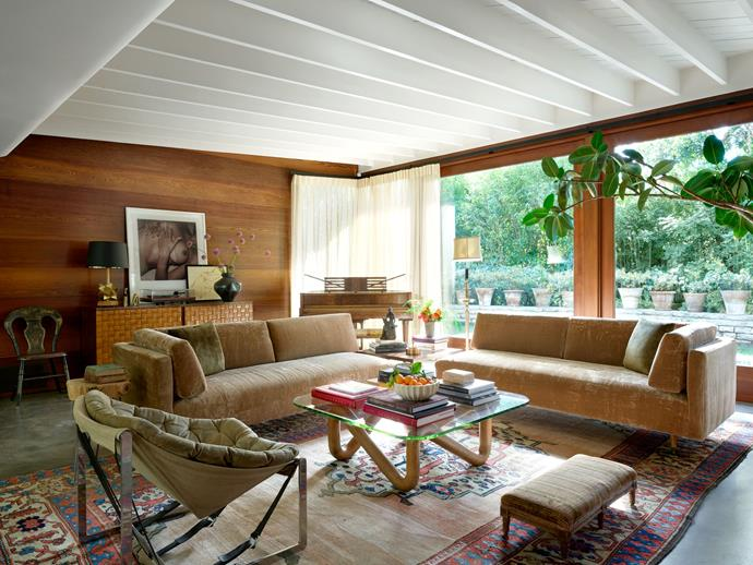 """The living room, overlooking the garden. <br><br> *Image by Simon Upton for [Architectural Digest](https://www.architecturaldigest.com/story/step-inside-dakota-johnsons-midcentury-modern-home