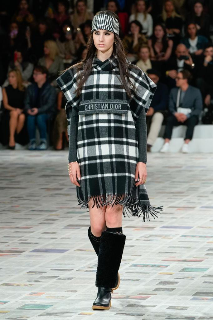 "**Ponchos**<br><br>  ""Oversized check ponchos balanced with skin-tight knitwear made a statement at Dior. Finish off the look with a wide headband tied across the forehead,"" said Wong.<br><br>  *Dior autumn/winter '20/'21*"