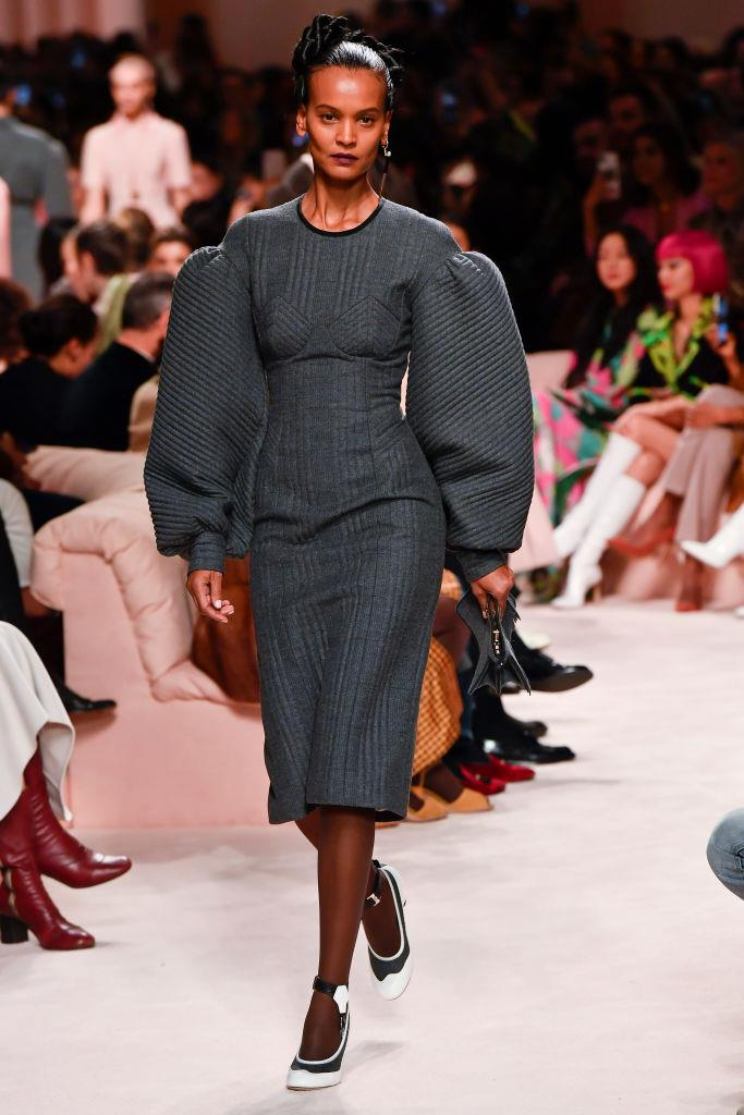 """**The New Workwear:**<br><br>  """"Corporate-style dressing gets an update with voluminous sleeves and corset-like waistlines,"""" explained Wong."""