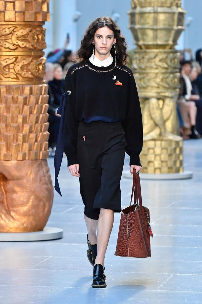 "**Preppy**<br><br>  ""Think: schoolboy-chic. Consider a loosely tucked sweater into (long) shorts, offset by the dainty earrings,"" said Wong.<br><br>  *Chloé autumn/winter '20/'21*"