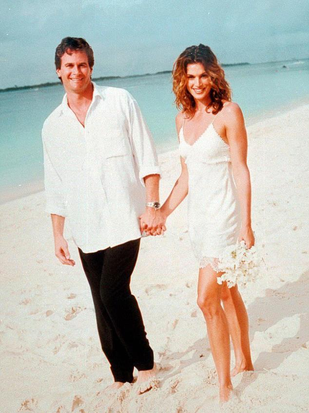**Cindy Crawford in John Galliano (1998)** <br><br> Taking the term 'laid-back bride' to a whole new level, the John Galliano slip that Cindy Crawford wore for her 1998 Bahamian marriage to Rande Gerber is *so* timeless. The supermodel later revealed that she told a stylist friend that she was attending a black-and-white party, in order to find a dress while keeping the forthcoming wedding a secret.
