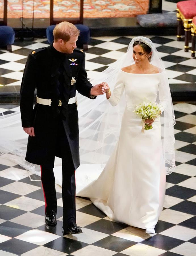 """**Meghan Markle in Givenchy (2018)** <br><br> While some commented on the [fit](https://www.harpersbazaar.com.au/fashion/meghan-markle-wedding-dress-fit-16564