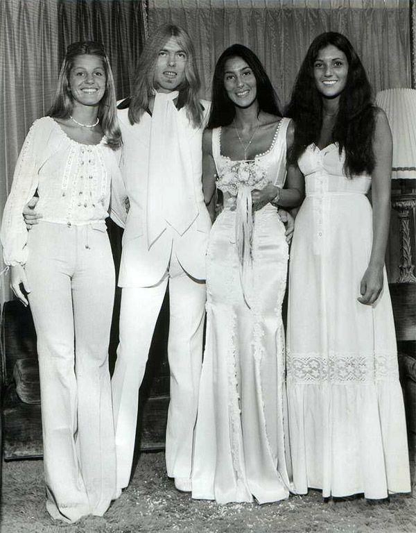 **Cher in an unidentified label (1975)** <br><br> Before Cher became ***Cher*** (AKA, the maximalist goddess we know and love today), she favoured much more pared-back style, and the streamlined silk gown she wore at her 1975 wedding to singer Greg Allman is all kinds of goals.