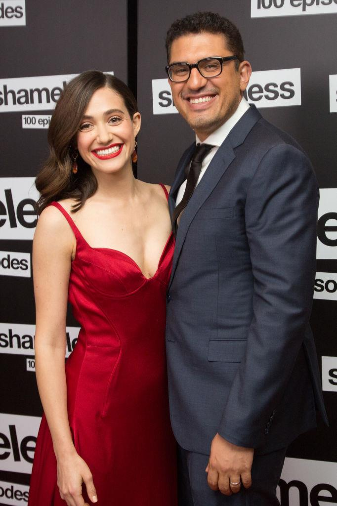 """**Emmy Rossum and Sam Esmail**<br><br>  Another proposal worthy of a rom-com? Film director Sam Esmail popping the question to Emmy Rossum.<br><br>  To ask the *Shameless* actress to marry him, Esmail had their love story printed in a faux version of *The New York Times'* """"Modern Love"""" section, which they read together every weekend.<br><br>  However, when Emsail asked Rossum to read it to him, things didn't quite go as expected.<br><br>  """"I said, 'I'm having a back spasm. I'm actually going to take a bath and have a glass of wine, but if you really want to hear it I'll read it to you from the bathtub,'"""" Rossum [revealed](https://www.vogue.com/article/emmy-rossum-wedding-2017-carolina-herrera